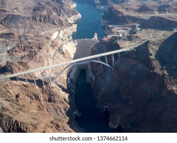 Hoover Dam, Nevada, USA seen from helicopter. Hoover Dam Bypass bridge is visible in front of it. Hoover Dam is a concrete dam on the Colorado River