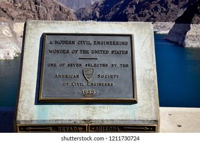 Hoover Dam, Nevada / USA - September 30, 2018: Memorial plaque at the Nevada - Arizona border at the center of the Hoover Dam over the Colorado River.