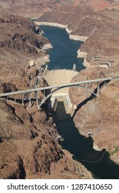 The Hoover Dam retaining the Colorado river in Nevada seen from a helicopter