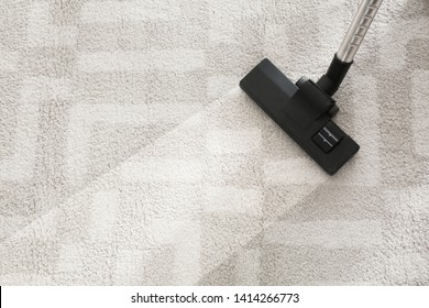Hoovering carpet with vacuum cleaner, top view. Space for text