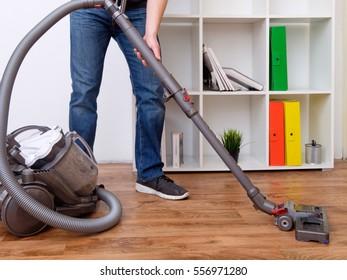 Hoovering a parquet floor