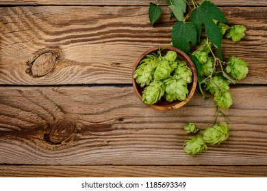 hop cones on a wooden background. Top view.