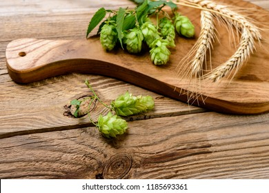 hop cones and wheat   on a wooden background. Top view.