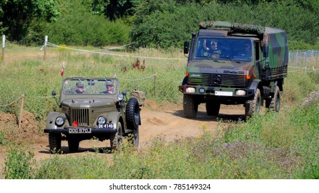 Hop Farm, Kent / UK - 07/27/17: GAZ 69E-68 in Polish army markings leading Mercedes Unimog 'Asterix' in Bundeswehr markings at 2017 War and Peace Revival.