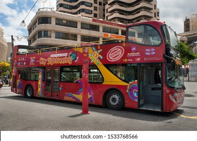 Hop on hop off bus, Santa Cruz de Tenerife, Canary Islands, Spain - June 20, 2014: open red double decker sightseeing bus at stop, popular attraction in Santa Cruz de Tenerife, Canary Islands, Spain