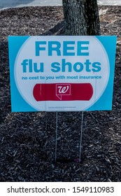 Hopatcong, NJ / USA - 11/1/19: Free Flu Shot red white and blue sign displayed during the Grand opening of new Walgreens after buying out Rite Aid stores.