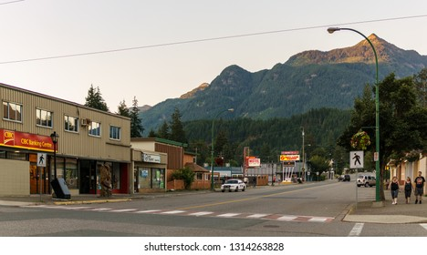 HOPE, CANADA - July 14, 2018: main street in small town in British Columbia with shops restaurants cars.