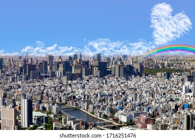 Hope, clouds and rainbow in the sky of tokyo