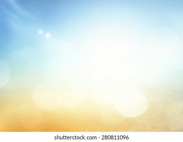 Hope concept: Abstract bokeh sun light with blurred yellow and blue color sky on beach background