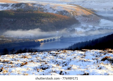 Hope, Derbyshire, UK. December 12, 2017.  Taken from Win Hill of Ashopton bridge and Ladybower reservoir at sunrise with morning mist over the valley at Hope in Derbyshire, UK.