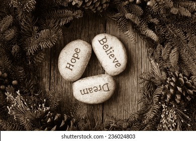 Hope, Dream, Believe in Text in the center of a Christmas Wreath