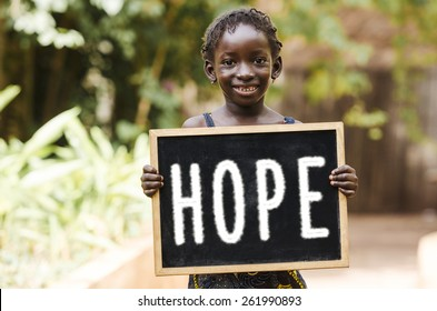 "Hope Symbol - Teenage Girl Holding Chalkboard Helping Hand. A girl holding a chalkboard with ""HOPE"" written on it."