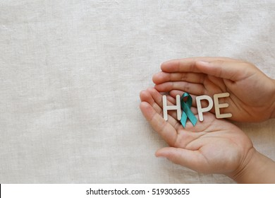 HOPE with Teal Ribbon on hands, Ovarian Cancer, cervical Cancer, pcos awareness