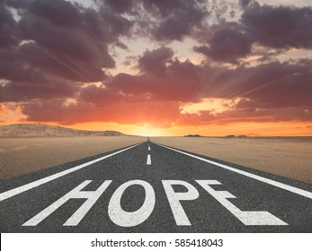 Hope text on highway inspirational concept