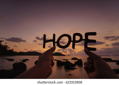 HOPE text silhouette over sunrise