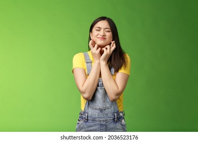 Hopeful nervous young female student faithfully praying willing win, taking part lottery, cross fingers good luck, begging god fulfill dream, wish come true, close eyes intense plead, supplicating