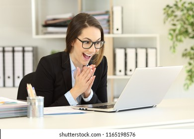 Hopeful office worker watching online content in a laptop