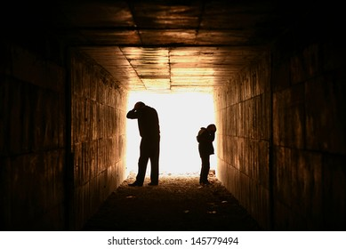 hopeless and helpless father and son in the tunnel