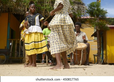 Hopkins Village, Belize - July 03, 2016: Garifuna troupe performs traditional songs with drumming and dancing in Hopkins Village.