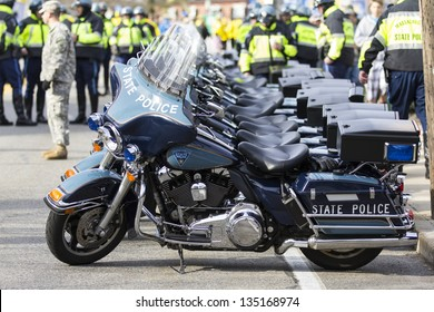 HOPKINTON  - APRIL 15: The Massachusetts State Police was present during the Boston Marathon 2013 coordinating the race with their Blue Harley Davidson bikes in Hopkinton, MA, USA on April 15, 2013.
