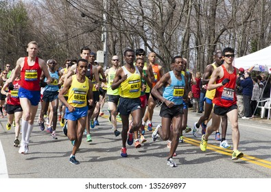 HOPKINTON, USA - APRIL 15: Elite Men Wave One right after the start of the Boston Marathon 2013 in Hopkinton heading to the finishing line Boston in Massachusetts, USA on April 15, 2013.