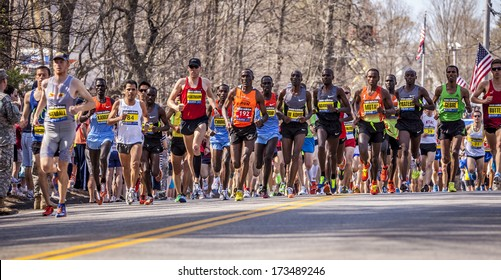 HOPKINTON, USA - APRIL 15: Runners of the Boston Marathon 2012 heading from Hopkinton to Boston downtown fast and steadily right after the start on April 15, 2012 in Hopkinton, Massachusetts, USA.