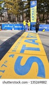 HOPKINTON, USA - APRIL 15: The starting line of the Boston Marathon 2013 in Hopkinton, Massachusetts, USA minutes before the start of the race been checked by staff people on April 15, 2013.