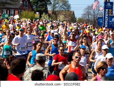 HOPKINTON, USA - APRIL 16, 2012: amateur athletes heading to Boston downtown a few minutes after the start of the Boston Marathon in Hopkinton, MA, USA on a very hot and sunny day on April 16, 2012.