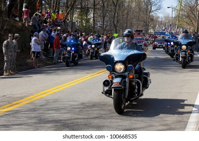 HOPKINTON, USA - APRIL 16: The Boston Marathon's starting line just after the beginning of the race with the Kenyans leading the competition in Hopkinton, Massachusetts, USA on April 16, 2012.
