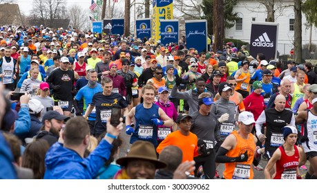 HOPKINTON, USA - APRIL 20: athgletes running the Boston Marathon 2015 a few minutes after the start of the competition in Hopkinton, MA, USA on April 20, 2015.
