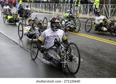 Hopkinton, USA - April 20: Athletes with disabilities competing in the Boston Marathon 2015 in Hopkinton, Massachusetts, USA a few seconds after the start of the race on April 20, 2015.