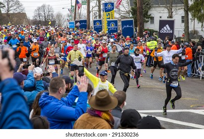 HOPKINTON, USA - APRIL 20: Athletes competing in the Boston Marathon 2015 a few minutes after the start of the race in Hopkinton, MA, USA facing a cold and raining day on April 20, 2015.