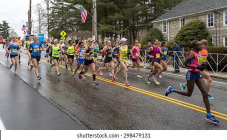 HOPKINTON, USA - APRIL 20: Elite female runners competing at the Boston Marathon 2015 a few minutes after the start of the race in Hopkinton, MA, USA on April 20, 2015.