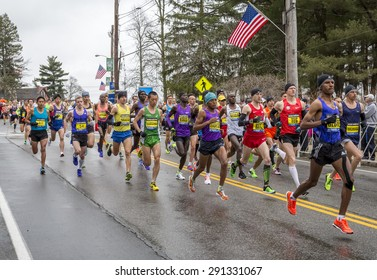 HOPKINTON, USA - APRIL 20: Male elite athletes competing in the Boston Marathon 2015 a few minutes after the start of the Race in Hopkinton, MA, USA facing a cold and raining day on April 20, 2015.