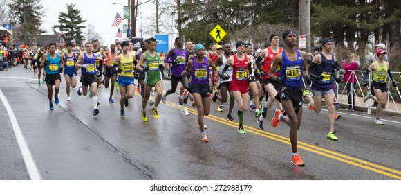 HOPKINTON, USA - APRIL 20: Runners heading to Boston downtown during the Boston Marathon 2015 a few minutes after the start of the competition in Hopkinton, Massachusetts, USA.