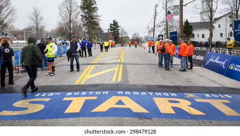 HOPKINTON, USA - APRIL 20: the starting line of the Boston Marathon 2015 with staff members, security personnel, and media people working a few minutes before the start of the race on April 20, 2015.