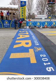 HOPKINTON, USA - APRIL 20: The starting line of the Boston Marathon 2015 in Hopkinton, MA, USA a few minutes before the start of the raceon April 20, 2015 with media people doing thsir jobs.