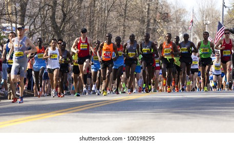 HOPKINTON, USA - APRIL16: Elite athletes at the 2012 Boston Marathon in Hopkinton, Massachusetts right after the start of the race with the Kenyan athletes leading the competition on April 16, 2012.