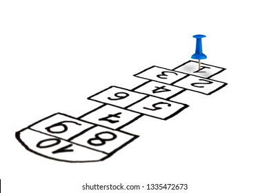 hopscotch game, children's game is drawn on a white background with a barrette in the player's seat at the start, the concept of development and promotion