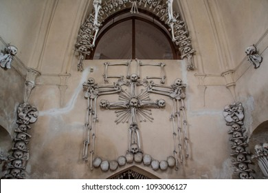 Kutná Hora / Czech Republic - 07/17/2017: Skulls and bones of every part of the human body are used as a interior of this church in Kutná Hora in the Czech Republic