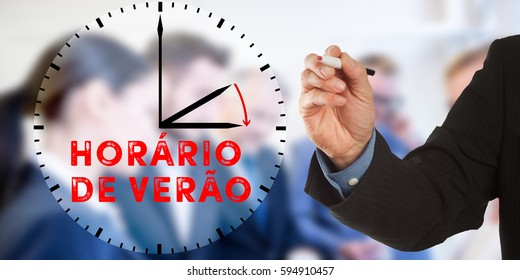 Horario de Verao, Portuguese Daylight Saving Time, Male hand in business wear holding a thick pen, writing on an imaginary screen at the camera, business team in background, digital composing.