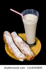 Horchata is a drink, made with the juice of tigernuts and sugar. Native from Valencia ? Spain, it is a refreshing drink, often accompanied with long thin buns called fartons.