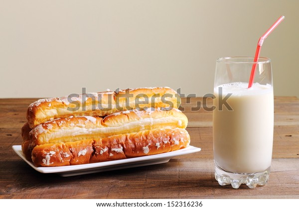 Horchata with fartons, a traditional beverage made of tigernuts and sponge pastries traditional from Valencia, Spain