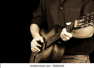 horisontal image of guitar and man