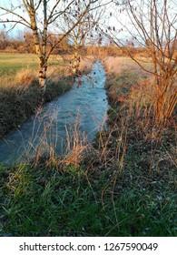 Horizon over water, rural scene at the river Strothe in the village of Schlangen