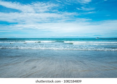Horizon of the sea ocean, wave of the sea on sand and blue sky background. Japan sea.