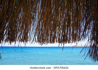 The Horizon of The Sea From Under A Thatched Roof