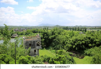 horizon view of china old town with the tower in field: Kaiping diaolou area, unesco world heritage site, blue sky in the meadow in Guangdong china