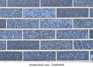 horizontal background of brick wall built of blue bricks