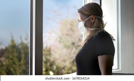 horizontal background of woman in isolation opening window taking fresh air against virus outbreak hypochondria .